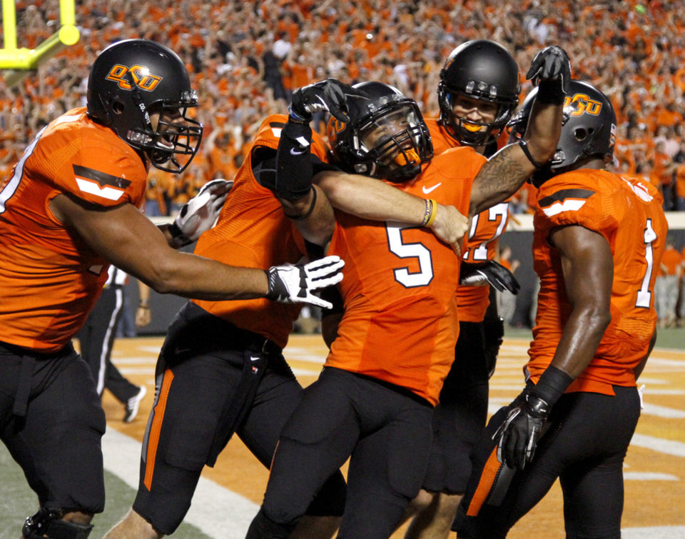 Photo - Oklahoma State's Josh Stewart (5) celebrates after catching a touchdown pass during a college football game between Oklahoma State University (OSU) and the University of Texas (UT) at Boone Pickens Stadium in Stillwater, Okla., Saturday, Sept. 29, 2012. Photo by Bryan Terry, The Oklahoman