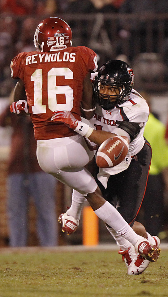 Photo - Texas Tech's Terrance Bullitt (1) breaks up a pass for Oklahoma's Jaz Reynolds (16) during the college football game between the University of Oklahoma Sooners (OU) and Texas Tech University Red Raiders (TTU) at the Gaylord Family-Oklahoma Memorial Stadium on Saturday, Oct. 22, 2011. in Norman, Okla. Photo by Chris Landsberger, The Oklahoman