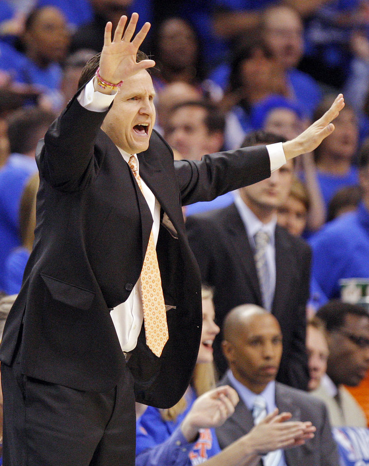 Photo - Oklahoma City head coach Scott Brooks gives instructionst to his team in the first half during game 7 of the NBA basketball Western Conference semifinals between the Memphis Grizzlies and the Oklahoma City Thunder at the OKC Arena in Oklahoma City, Sunday, May 15, 2011. Photo by Nate Billings, The Oklahoman