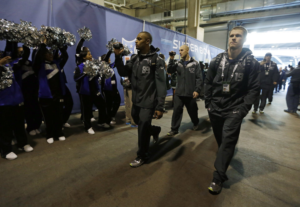 Photo - Seattle Seahawks players shoot video as they arrive for media day for the NFL Super Bowl XLVIII football game Tuesday, Jan. 28, 2014, in Newark, N.J. (AP Photo/Jeff Roberson)