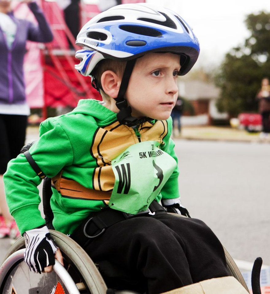 Photo -  A close up of four-year-old Ryder Gibson and his ninja turtle jacket as he pushes off the starting line of the Redbud Classic at Nichols Hills Plaza in Nichols Hills, OK, Sunday, April 6, 2014. Photo by KT King, The Oklahoman