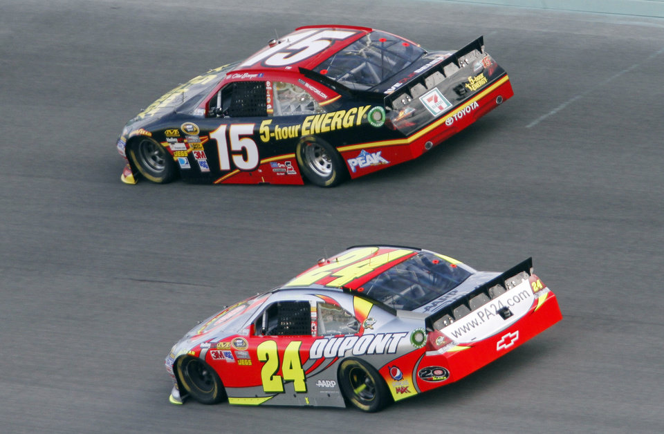 Clint Bowyer (15) and Jeff Gordon (24) compete during the NASCAR Sprint Cup Series auto race at Homestead-Miami Speedway, Sunday, Nov. 18, 2012, in Homestead, Fla. (AP Photo/David Graham)