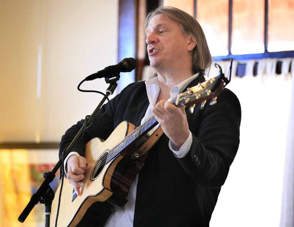 "Guitarist/singer Ellis Paul performs songs from his newest family music album, ""The Hero in You,"" Sunday at the Santa Fe Depot."