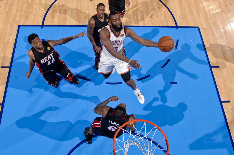In this photo taken with an NBA camera placed above the basket, OKC Thunder\'s James Harden goes against the Miami Heat\'s LeBron James in the NBA Finals in Game 2 in Oklahoma City. PHOTO BY ANDREW D. BERNSTEIN, NBAE/Getty Images.