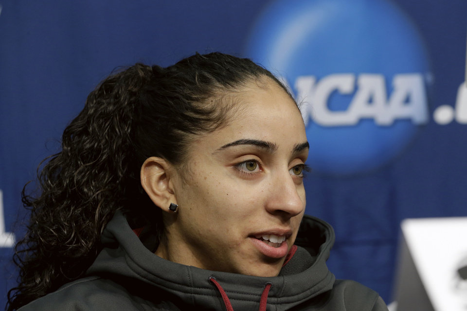 Photo - Florida State's Cheetah Delgado speaks at a news conference in Ames, Iowa, Sunday, March 23, 2014. Florida State will play Stanford in the second round of the NCAA women's college basketball tournament in Ames on Monday. (AP Photo/Nati Harnik)