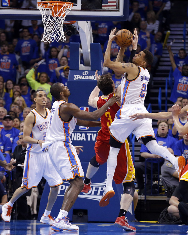 Oklahoma City's Thabo Sefolosha (2) tries to drive to the basket as Omer Asik (3)during Game 5  in the first round of the NBA playoffs between the Oklahoma City Thunder and the Houston Rockets at Chesapeake Energy Arena in Oklahoma City, Wednesday, May 1, 2013. Photo by Sarah Phipps, The Oklahoman