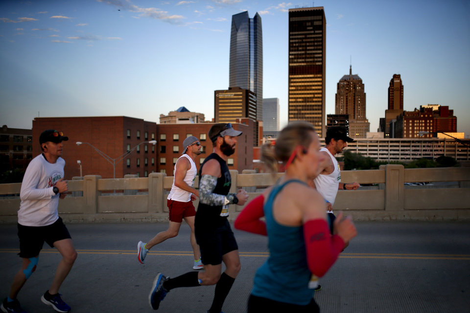 Photo - Runners make their way up Walnut Street during Oklahoma City Memorial Marathon in Oklahoma City, Sunday, April 28, 2019. [Sarah Phipps/The Oklahoman]