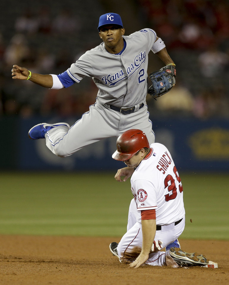 Photo - Los Angeles Angels' J.B. Shuck, is forced out at second by Kansas City Royals shortstop Alcides Escobar after Erick Aybar hit into a double play during the fourth inning of a baseball game in Anaheim, Calif., Wednesday, May 15, 2013. (AP Photo/Chris Carlson)