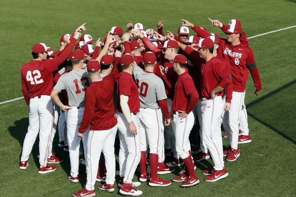 Photo - The OU Sooners gather together during practice for the University of Oklahoma baseball team at L. Dale Mitchell Park in Norman, Okla., Friday, Feb. 7, 2020. [Nate Billings/The Oklahoman]
