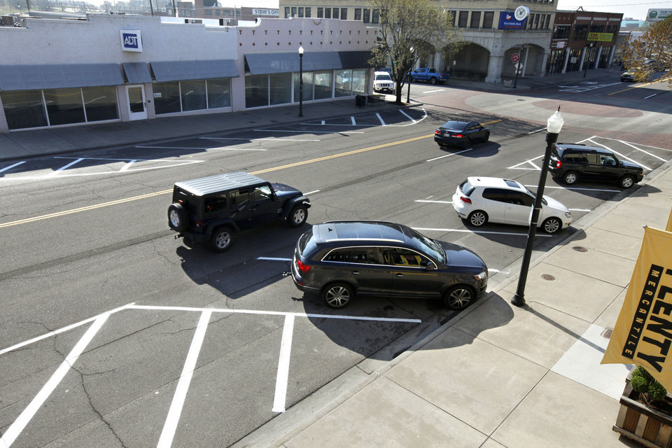Photo -       Automobile Alley merchants, businesses and property owners requested angle parking on Broadway for years as they sought to slow traffic and make the area friendlier for pedestrians.   PAUL HELLSTERN -  Oklahoman