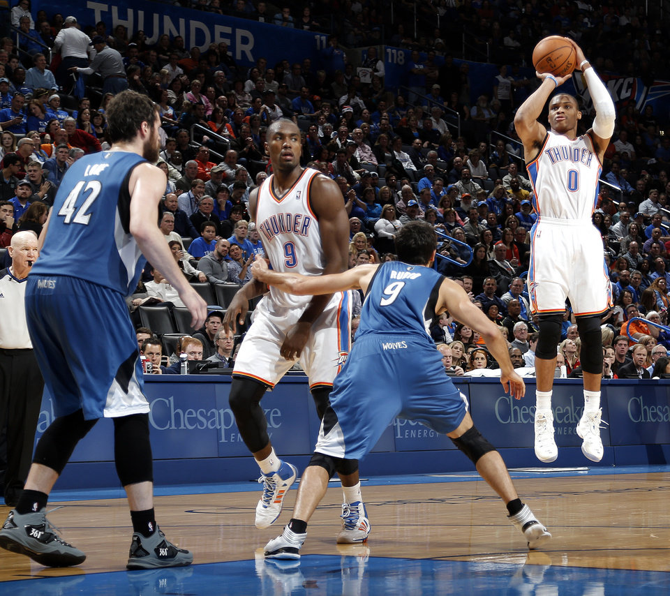 Photo - Oklahoma City's Russell Westbrook (0) shoots a three pointer during the NBA game between the Oklahoma City Thunder and the Minnesota Timberwolves at the Chesapeake Energy Arena, Sunday, Dec. 1, 2013. Photo by Sarah Phipps, The Oklahoman