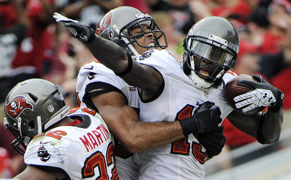 Photo -   Tampa Bay Buccaneers wide receiver Mike Williams (19) celebrates with wide receiver Vincent Jackson (83) and running back Doug Martin (22) after catching a touchdown pass during the first quarter of an NFL football game, Sunday, Sept. 9, 2012, in Tampa, Fla. (AP Photo/Brian Blanco)
