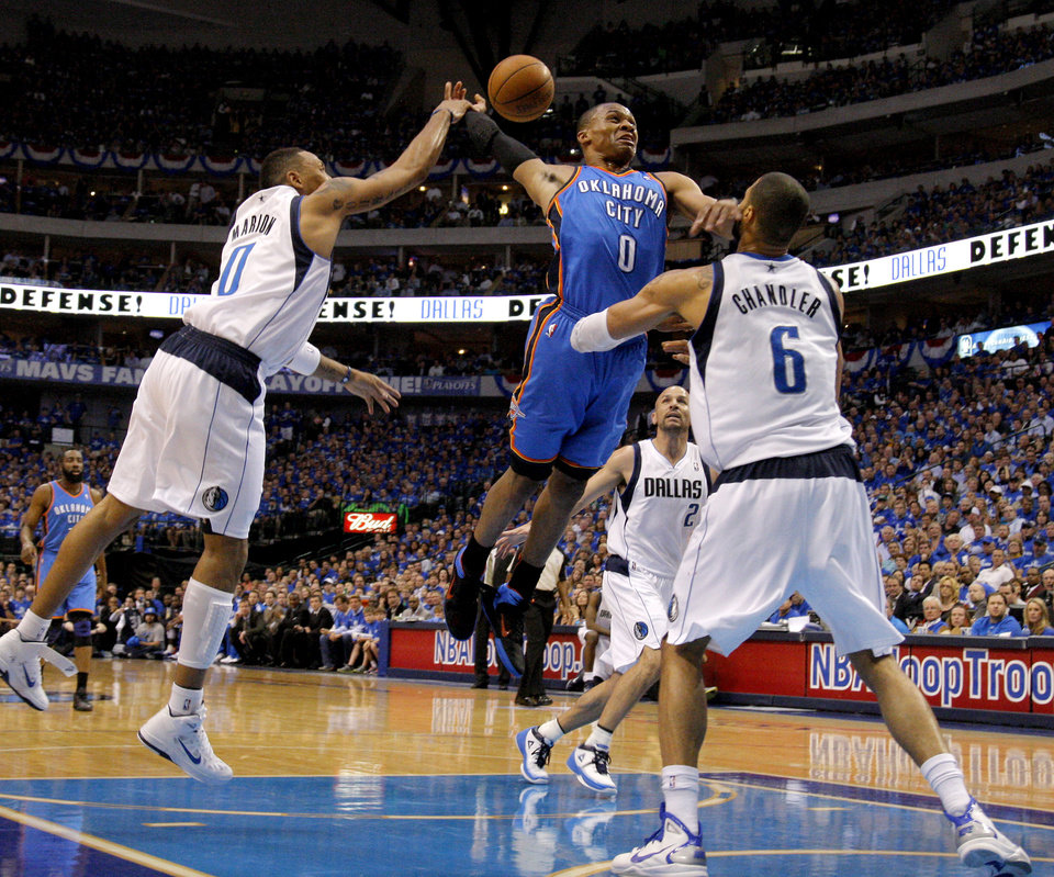 Photo - Oklahoma City's Russell Westbrook (0) has his shot blocked between Shawn Marion (0) and Tyson Chandler (6) of Dallas as Jason Kidd (2) watches during game 5 of the Western Conference Finals in the NBA basketball playoffs between the Dallas Mavericks and the Oklahoma City Thunder at American Airlines Center in Dallas, Wednesday, May 25, 2011. Photo by Bryan Terry, The Oklahoman