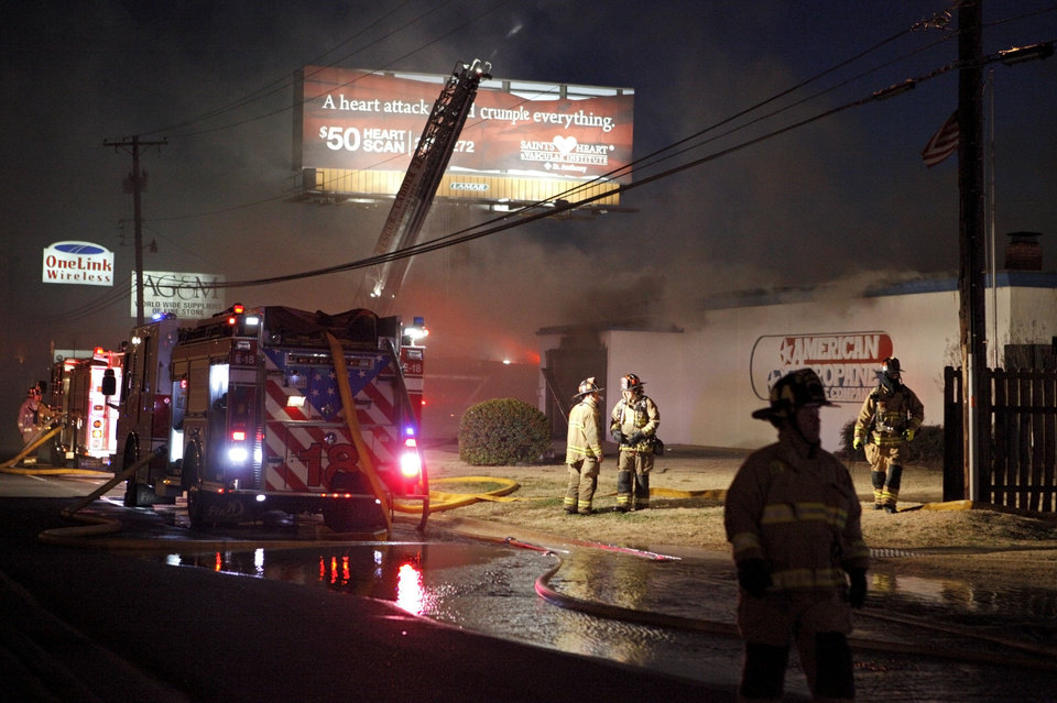 Photo - Oklahoma City firefighters respond to a fire Thursday at American Propane Gas Co. at 7401 Broadway  Extension. Photo by Bryan Terry, The Oklahoman