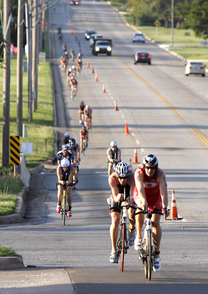 Bryan Williams leads a pack of bicyclers up McArthur Blvd. during the Redman Triathlon in Oklahoma City, OK, Saturday, September 22, 2012,  By Paul Hellstern, The Oklahoman