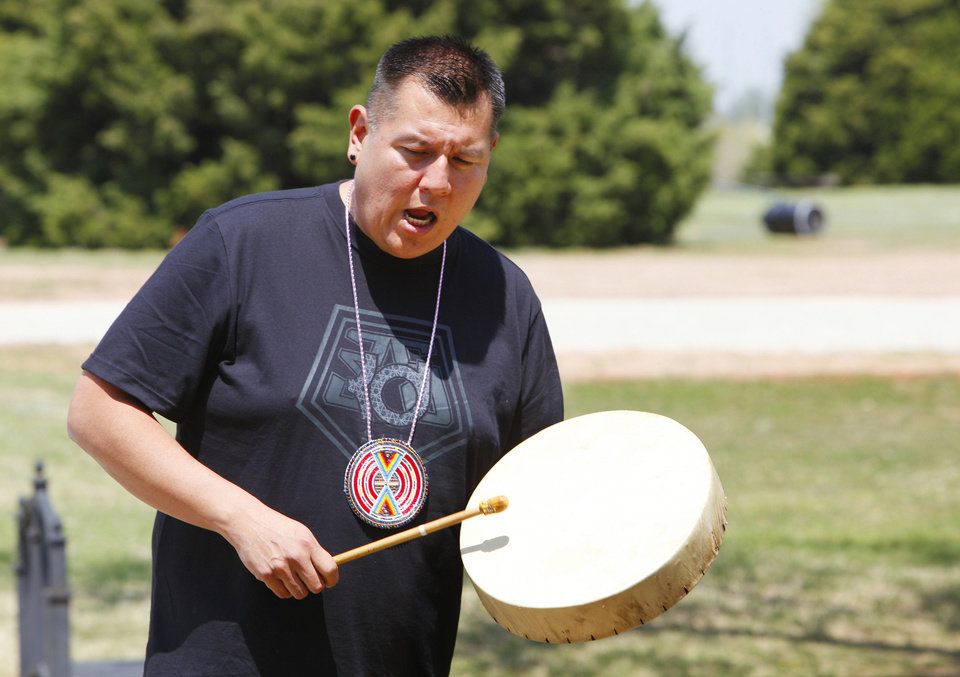 Everett Moore, of Jones, sings and beats a drum to accompany American Indian dancers during a Red Earth Day event at King�s Gate Christian School.