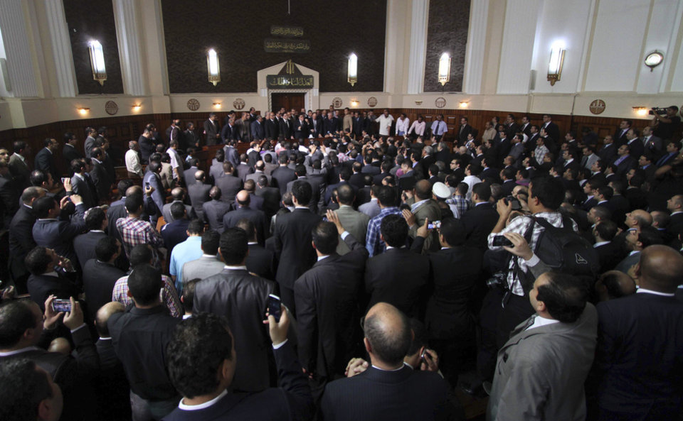 Photo -   Egyptian Prosecutor General Abdel-Meguid Mahmoud speaks to hundreds of supporters, judges, lawyers and media in a downtown courthouse defying a presidential decision to remove him from his post, saying this infringes on the judiciary's independence, in Cairo, Egypt, Saturday, October 13, 2012. President Mohammed Morsi ordered Prosecutor General Abdel-Meguid Mahmoud to step down to appease public anger over the acquittals of ex-regime officials accused of orchestrating violence against protesters last year. (AP Photo/Ahmed Gomaa)