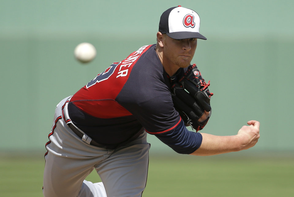 Photo - Atlanta Braves' David Carpenter delivers a warm-up pitch in the fourth inning of an exhibition baseball game against the Boston Red Sox, Friday, March 7, 2014, in Fort, Myers, Fla. The Red Sox won 4-1 over the Braves. (AP Photo/Steven Senne)