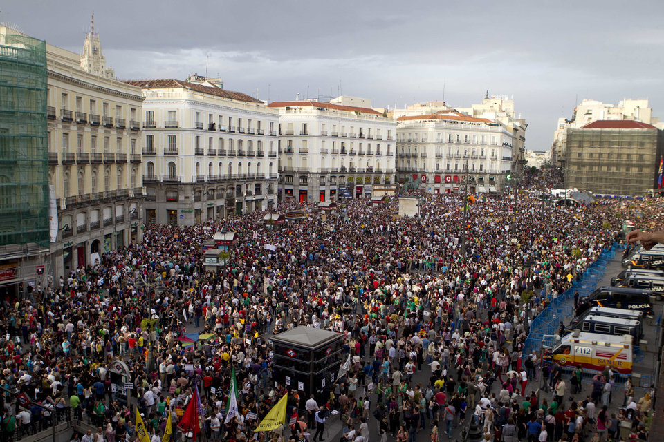 Photo - FILE - In this May 12, 21012 file photo, protesters pack the Puerta del Sol plaza in central Madrid. Worldwide growth was slack again in 2012. The global economy grew just 3.3 percent, down from 3.8 percent in 2011 and 5.1 percent in 2010, the International Monetary Fund estimates. (AP Photo/Paul White, File)