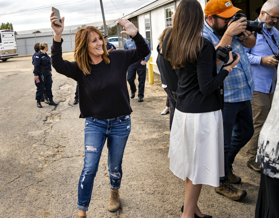 Photo - Veronica Hughes cheers as she waits for her daughter Danni Roberts to be released from the Dr. Eddie Warrior Correctional Facility on Monday, Nov. 4, 2019 in Taft, Okla. Governor Kevin Stitt greeted an estimated 70 women whose sentences he commuted from the facility. [Chris Landsberger/The Oklahoman]