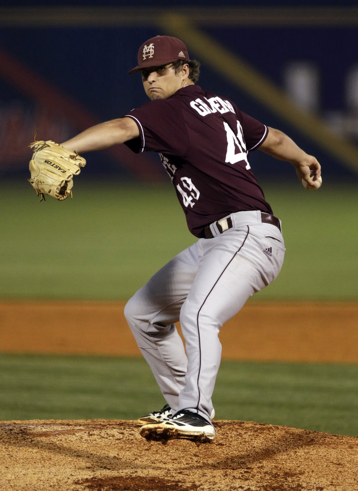 Photo - Mississippi State's Kendall Graveman throws in the first inning of their Southeastern Conference Tournament NCAA college baseball game against Texas A&M at the Hoover Met in Hoover, Ala., Thursday, May 23, 2013. (AP Photo/Dave Martin)