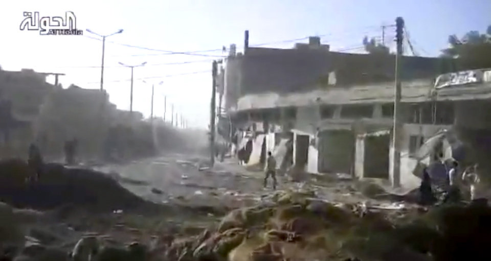 Photo -   This image taken from video obtained from Shaam News Network, which has been authenticated based on its contents and other AP reporting, shows a general view of a neighborhood following heavy bombing from military warplanes in Houla, Syria, Tuesday, Nov. 6, 2012. The Britain-based Syrian Observatory for Human Rights said air raids on Houla, a group of villages in central province of Homs, killed several people.(AP Photo/Shaam News Network via AP video)