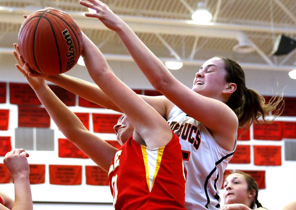 Dale\'s Danielle Dockrey, left, fights for the rebound with Taylor McAreavey as the Tonkawa Lady Bucs play the Dale Lady Pirates in class 2A State Playoff girls basketball at Westmoore High School on Thursday, March 7, 2013, in Moore, Okla. Photo by Steve Sisney, The Oklahoman