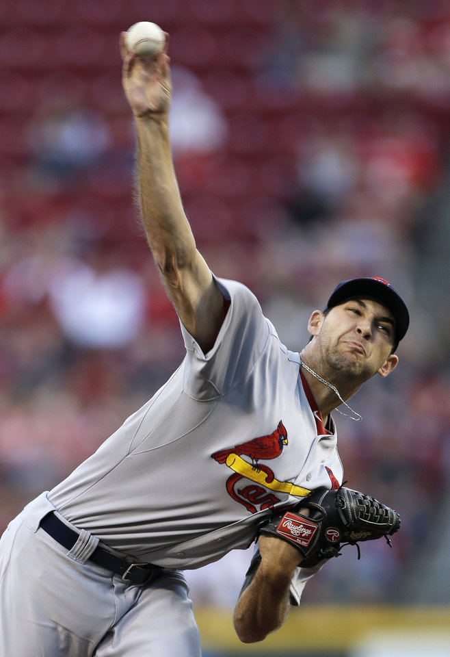 Photo - St. Louis Cardinals starting pitcher Michael Wacha throws to a Cincinnati Reds batter in the first inning of a baseball game, Tuesday, Sept. 3, 2013, in Cincinnati. (AP Photo/Al Behrman)