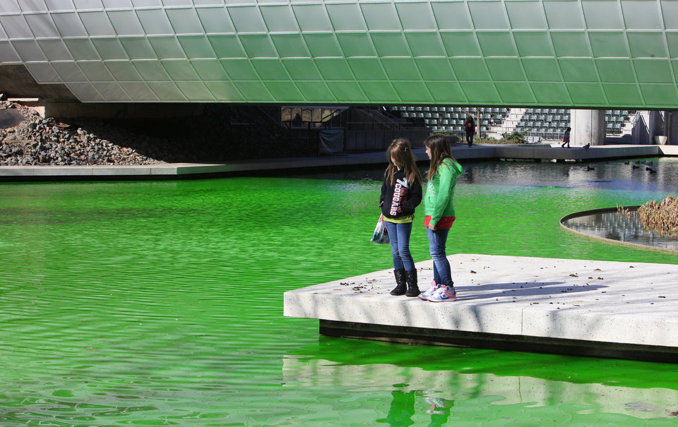 Photo -      Shawnee residents Brianna Arnold, age 11, and Paige Iddings, age 10, look at the green water.   PAUL B. SOUTHERLAND -