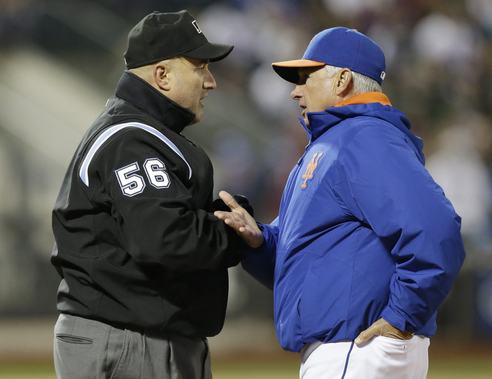 Photo - New York Mets manager Terry Collins, right, argues a call by first base umpire Eric Cooper during the third inning of a baseball game against the Atlanta Braves, Friday, April 18, 2014, in New York. (AP Photo/Frank Franklin II)