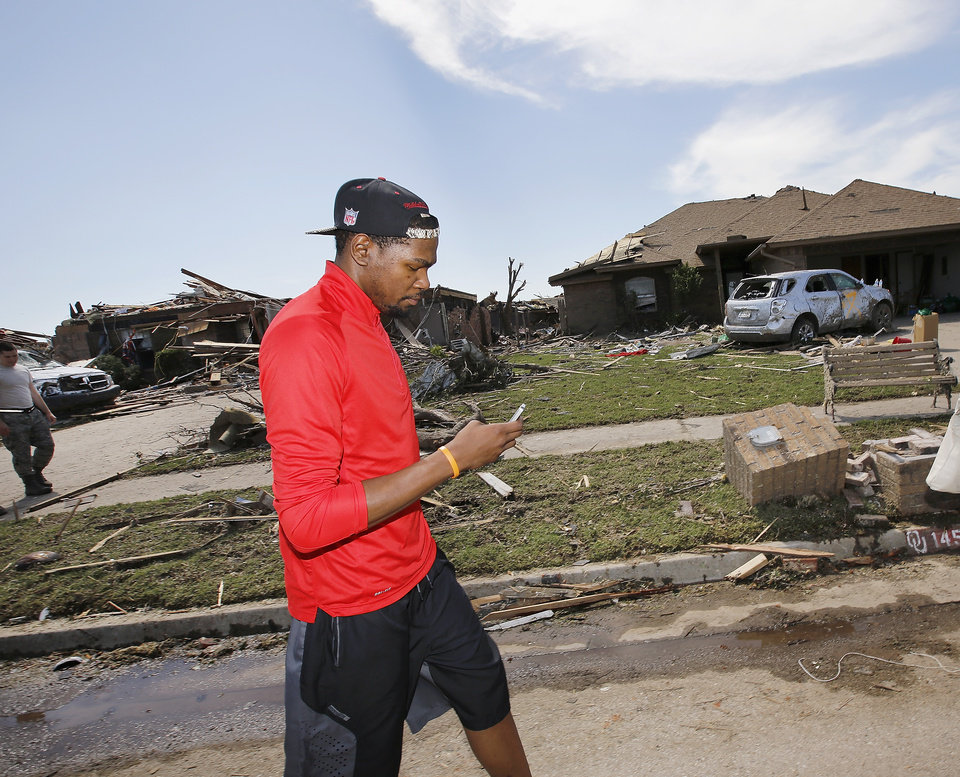 Oklahoma City Thunder's Kevin Durant toured a southwest Oklahoma City neighborhood that took a direct hit in last Monday's F5 tornado to offer words of support and encouragement to homeowners and volunteers assisting with the relief effort. Durant walked several blocks along S. Hudson, near SW 145, on Wednesday afternoon, May 22, 2013, and also visited Briarwood School, the heavily damaged elementary school in the same neighborhood.     Photo  by Jim Beckel, The Oklahoman.