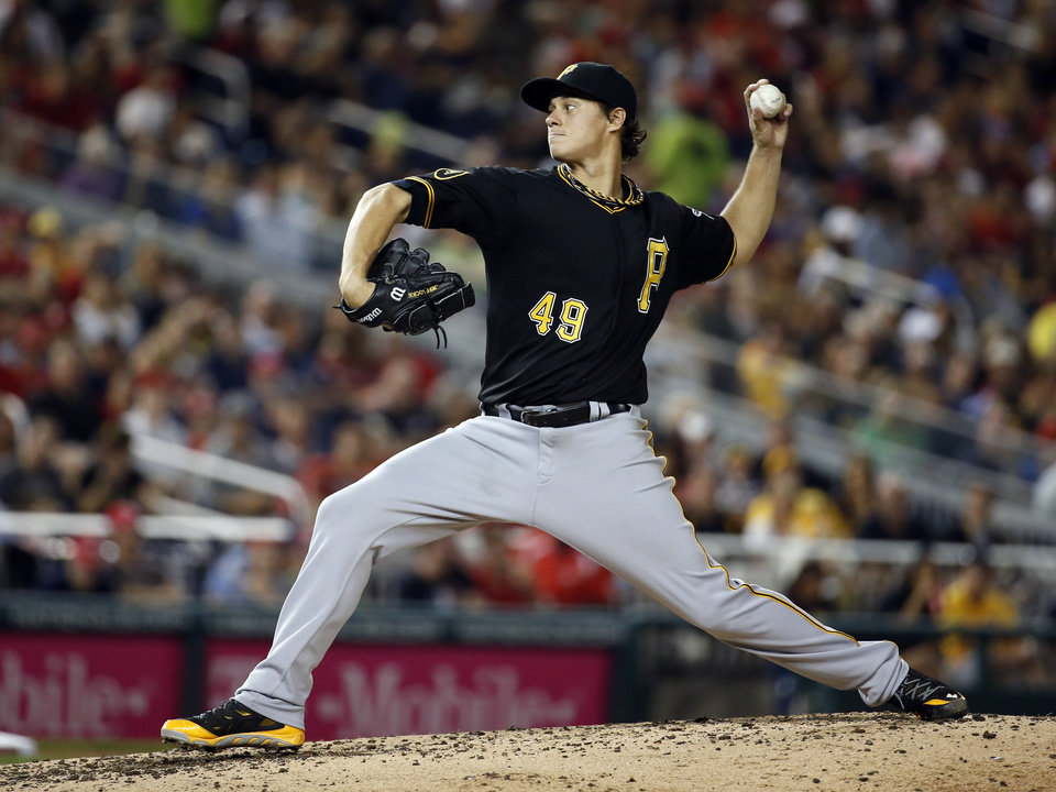 Photo - Pittsburgh Pirates starting pitcher Jeff Locke throws during the fourth inning of a baseball game against the Washington Nationals at Nationals Park, Saturday, Aug. 16, 2014, in Washington. (AP Photo/Alex Brandon)