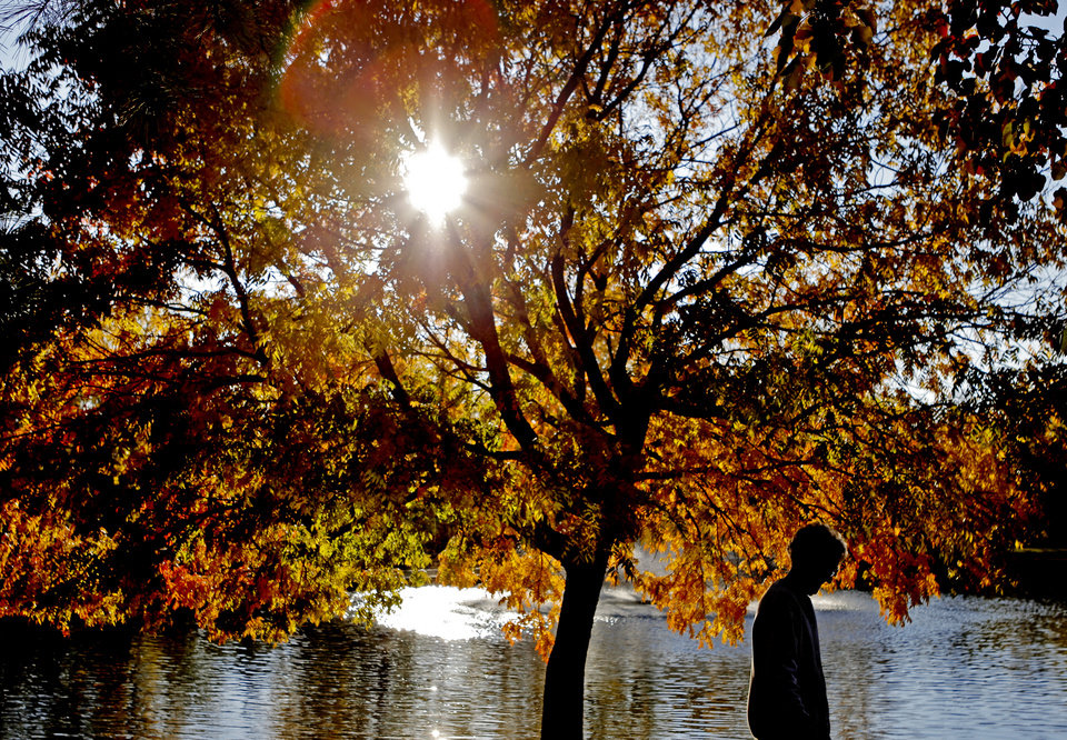 Lillian Emerson of Edmond walks past a colorful tree at Hafer Park in Edmond, Okla., Thursday, Nov. 10, 2011. Photo by Bryan Terry, The Oklahoman