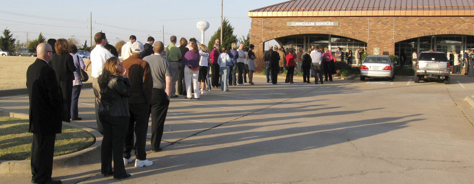 Photo - Voters line up Tuesday, Nov. 4, 208, morning outside a polling place at the Edmond Public Schools Administrative Offices at Danforth and Kelly before 8 a.m. The lines stretched along the side of the building into the parking lot. BY JOHN WILLIAMS, THE OKLAHOMAN