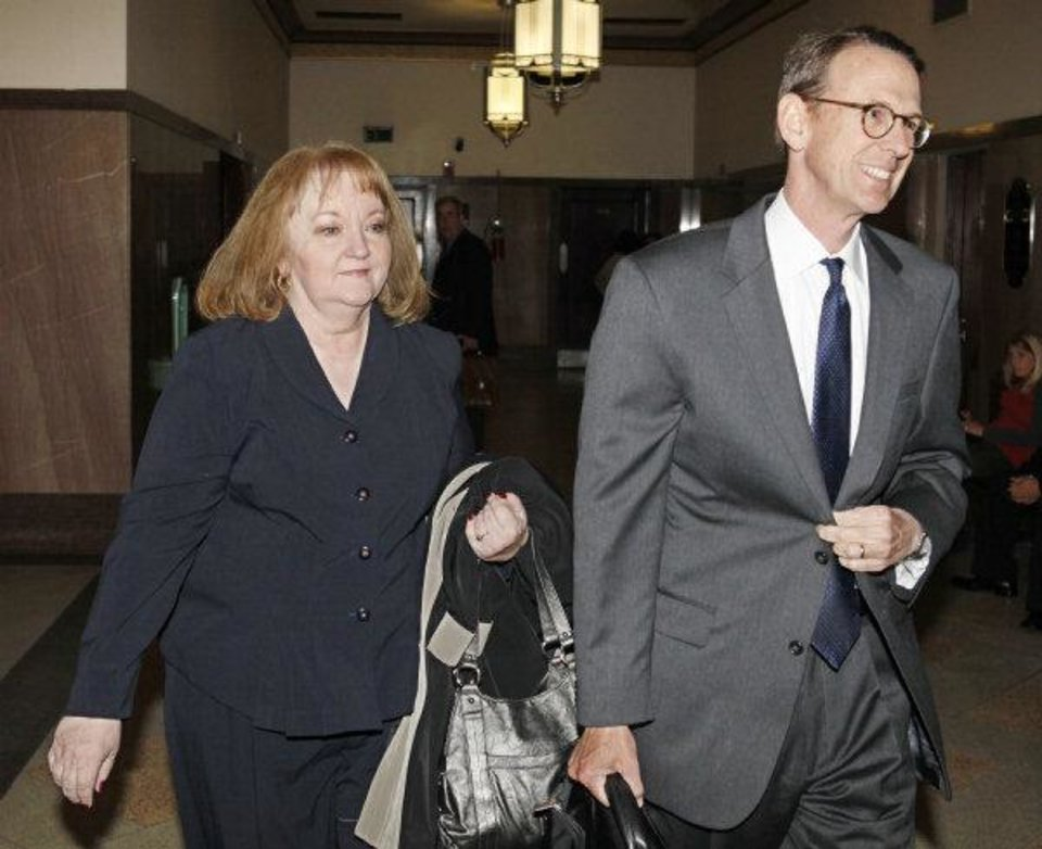 Photo - Former Sen. Debbe Leftwich arrives Friday with her attorney, Robert McCampbell, for a hearing in her bribery case.   Steve Gooch - The Oklahoman
