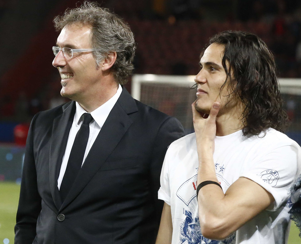 Photo - Paris Saint-Germain's coach Laurent Blanc, left, and Uruguayan Edinson Cavani, right, stand together after the French league one soccer match between Paris-Saint-Germain and Rennes at Parc des Princes stadium in Paris, Wednesday, May 7, 2014. Paris Saint- Germain clinched their second straight French league title on Wednesday after rival Monaco drew 1-1 against French Cup holder Guingamp. (AP Photo/Michel Euler)