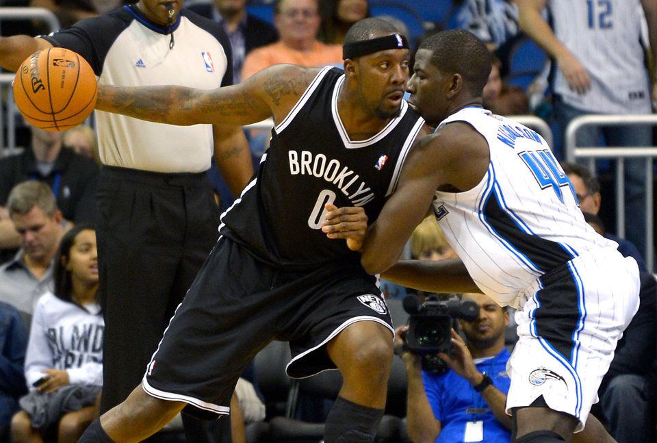 Photo -   Brooklyn Nets center Andray Blatche (0) drives to the basket against Orlando Magic forward Andrew Nicholson (44) during the second half of an NBA basketball game in Orlando, Fla., Friday, Nov. 9, 2012. The Nets won 107-68.(AP Photo/Phelan M. Ebenhack)