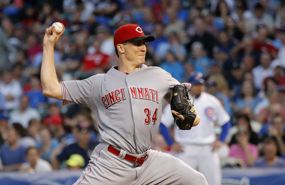 Photo - Cincinnati Reds starting pitcher Homer Bailey delivers during the first inning of a baseball game against the Chicago Cubs on Tuesday, June 24, 2014, in Chicago. (AP Photo/Charles Rex Arbogast)