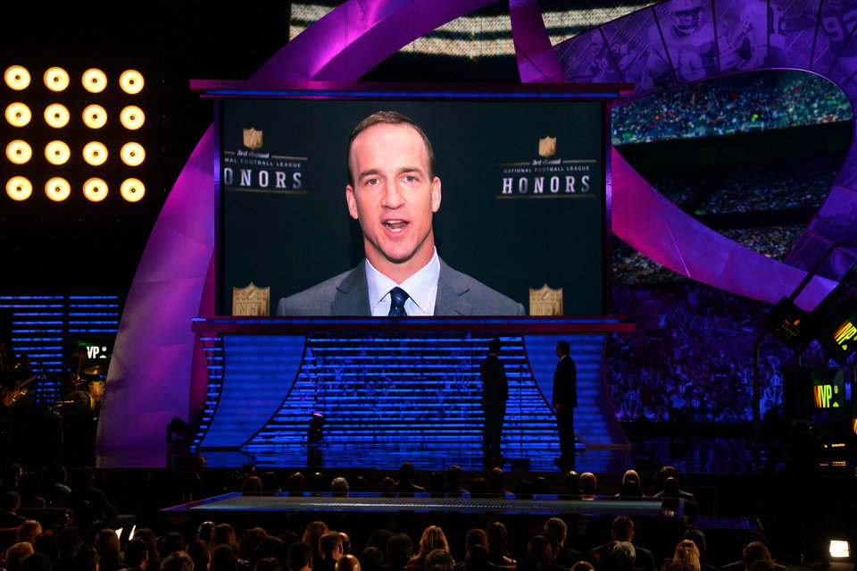 Photo - Peyton Manning of the Denver Broncos appears onscreen to accept the award for AP Most Valuable Player, at the third annual NFL Honors at Radio City Music Hall on Saturday, Feb. 1, 2014, in New York. (Photo by Evan Agostini/Invision for NFL/AP Images)