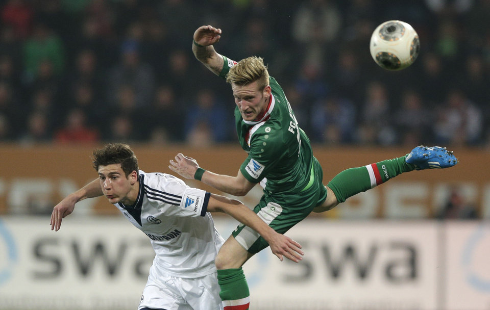 Photo - Schalke's Leon Goretzka, left, and Augsburg's Andre Hahn challenge for the ball during the German first division Bundesliga soccer match between FC Augsburg and FC Schalke 04, in Augsburg, southern Germany, Friday, March 14, 2014. (AP Photo/Matthias Schrader)