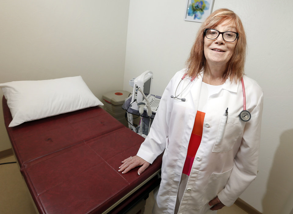 Photo -  Dr. Laura Arrowsmith poses for a photo in an examination room at 1240 SW 44 St. in Oklahoma City. Arrowsmith has opened a practice catering to the needs of transgender people. [Photo by Nate Billings, The Oklahoman]
