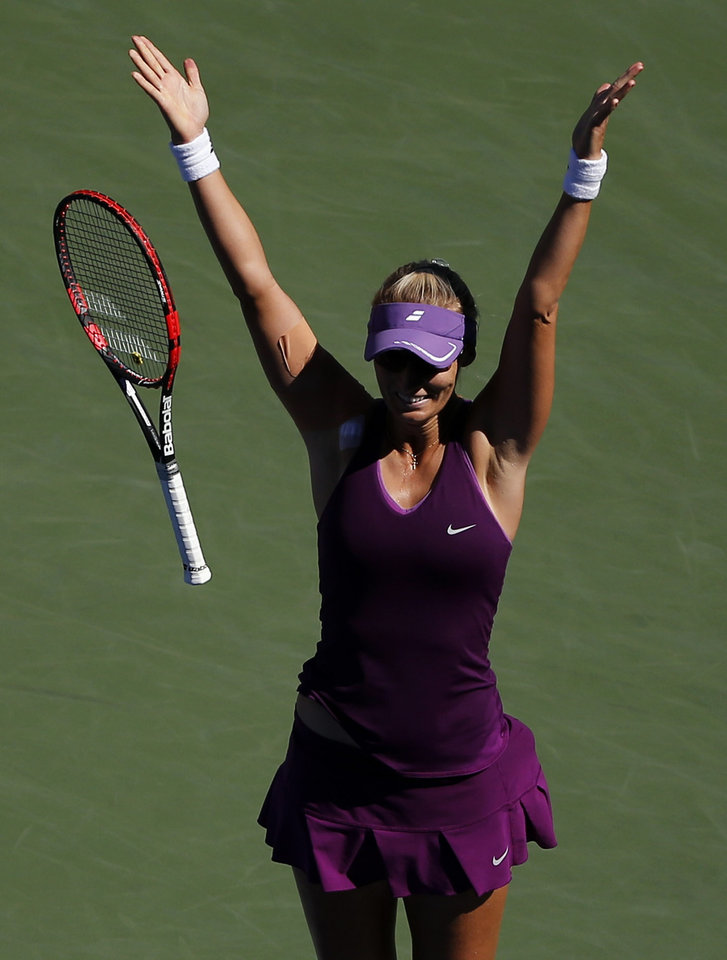 Photo - Mirjana Lucic-Baroni, of Croatia, reacts after defeating Simona Halep, of Romania, during the third round of the 2014 U.S. Open tennis tournament, Friday, Aug. 29, 2014, in New York. (AP Photo/Elise Amendola)