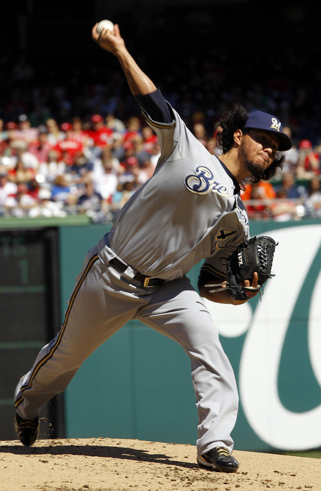 Photo -   Milwaukee Brewers starting pitcher Yovani Gallardo delivers to the Washington Nationals during the first inning of a baseball game in Washington, Sunday, Sept. 23, 2012. (AP Photo/Ann Heisenfelt)