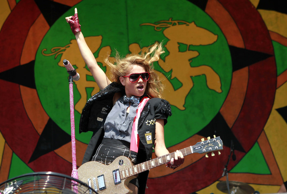Photo -   Paulina Rubio performs at the New Orleans Jazz and Heritage Festival in New Orleans, Saturday, May 5, 2012. (AP Photo/Gerald Herbert)