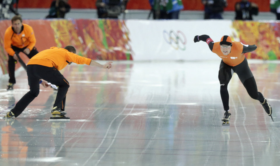 Photo - Coach gerard Kemkers urges on Sven Kramer of the Netherlands as he competes in the men's 5,000-meter speedskating race at the Adler Arena Skating Center at the 2014 Winter Olympics in Sochi, Russia, Saturday, Feb. 8, 2014. With the 10,000 meters as good as won four years ago in Vancouver, Kemkers inexplicably pointed Kramer toward the wrong lane on a crossover in the10,000 meters and Kramer, just as inexplicably, followed that road to Olympic ruin. (AP Photo/Matt Dunham)