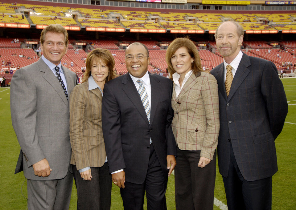 Photo - ESPN Monday Night Football television personalities from left, Joe Theisman, Suzy Kolber, Mike Tirico, Michele Tafoya and Tony Kornheiser pose for a photo before the Washington Redskins-Minnesota Vikings NFL football game, Monday, Sept. 11, 2006, in Landover, Md.(AP Photo/Nick Wass) ORG XMIT: FDX201