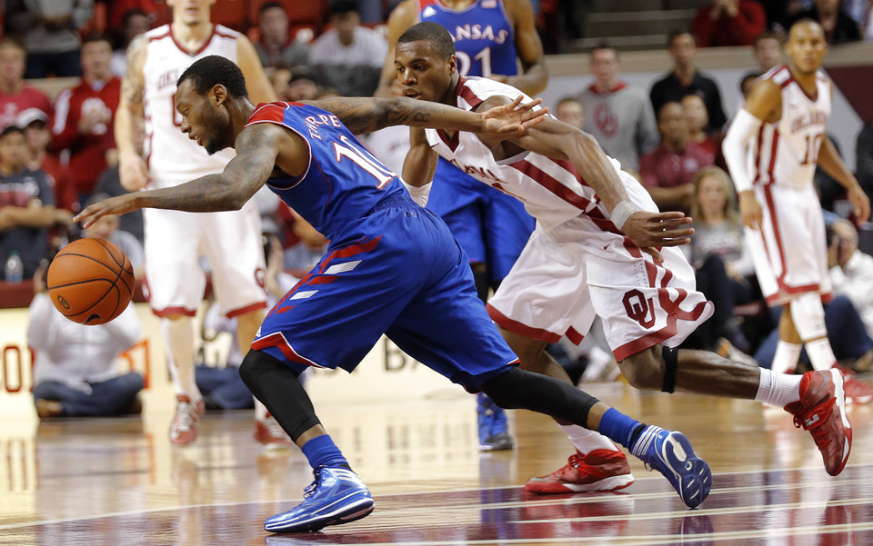 Photo - Kansas' Naadir Tharpe (10) drives the ball past Oklahoma's Buddy Hield (24) during the NCAA college basketball game between the University of Oklahoma Sooners (OU) and the University of Kansas (KU) Jayhawks at Lloyd Nobel Center in Norman,  Okla. on Wednesday, Jan. 8, 2014.   .Photo by Chris Landsberger, The Oklahoman
