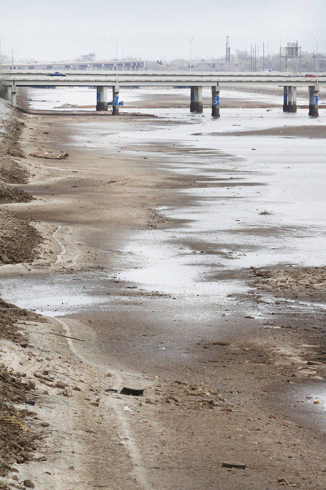 The eastern basin of the Oklahoma River lays dry near I-40 in Oklahoma City, Friday December 14, 2012. Photo By Steve Gooch, The Oklahoman <strong>Steve Gooch - The Oklahoman</strong>