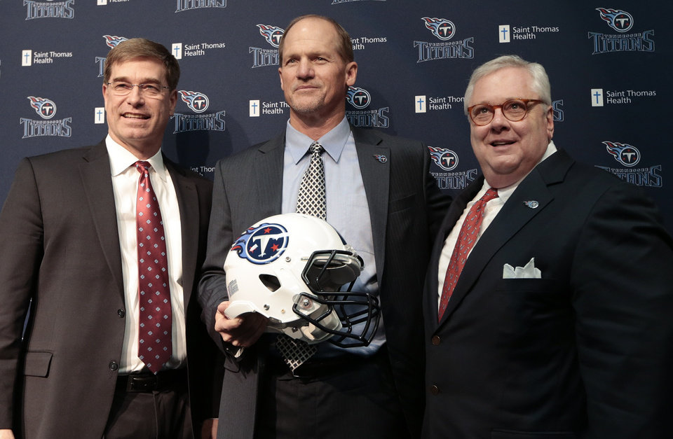 Photo - Tennessee Titans coach Ken Whisenhunt, center, poses for pictures with general manager Ruston Webster, left, and president and CEO Tommy Smith at a news conference Tuesday, Jan. 14, 2014, in Nashville, Tenn. The Titans introduced Whisenhunt as their 17th head coach and only their third different coach since moving from Houston to Tennessee. (AP Photo/Mark Humphrey)
