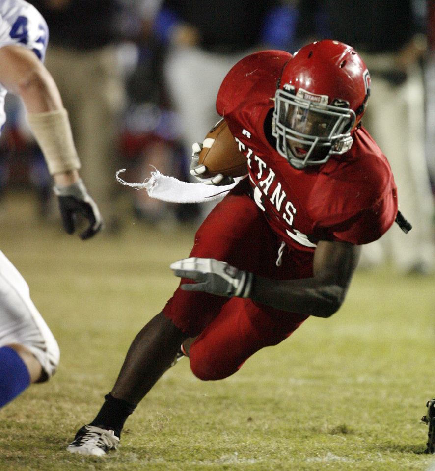 David Oku (23) cuts up field as Carl Albert plays Guthrie in high school football at Jim Harris Stadium  in Midwest City, Oklahoma on Thursday October 16, 2008.  